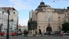 Bratislava: tram passing near Slovak Philharmonic concert hall Stock Footage
