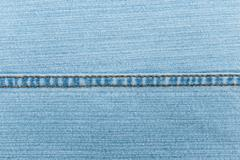 blue jeans texture with seam - stock photo