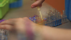 Young girl loom 9 Stock Footage