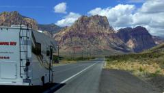 El Monte Rental RV On Highway At Red Rock Canyon Stock Footage