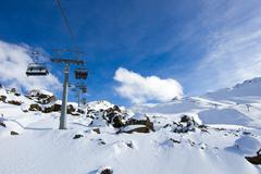 chairlift above rocks - stock photo