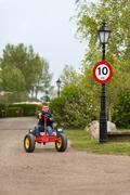 Boy driving pedal go cart Stock Photos