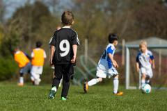 kids practicing soccer - stock photo