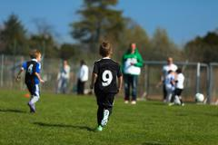 boys playing soccer - stock photo