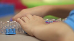 Young girl loom 5 Stock Footage