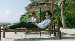 Businesspeople working in exotic place Stock Footage