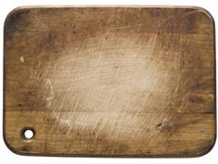 Used wooden cutting board Stock Photos
