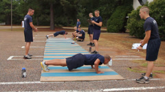 Alert Academy recruits strain to do pushups - stock footage