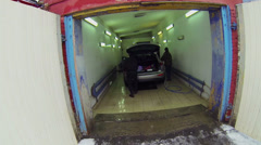 Men work in car wash in Moscow. Aerial view. Stock Footage