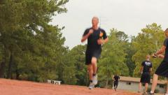 Military Academy recruits run laps for physical training Stock Footage