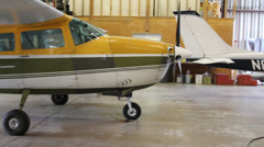 Cessna 206 Airplanes Parked in a Flight School Hangar Stock Footage
