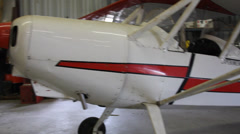Pan Shot of a Bakeng Duce Airplane Parked in a Hangar Stock Footage