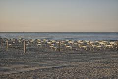 Deckchairs and umbrellas on the adriatic coast Stock Photos