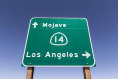 mojave desert freeway sign to los angeles - stock photo