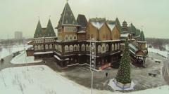 Christmas tree stands near wooden palace in Kolomenskoye Stock Footage