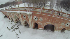 Few people on bridge over ravine in Tsaritsyno Stock Footage