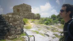 Man watches the horizon in tulum Stock Footage