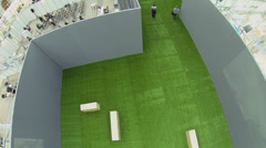 Green carpet between rows of pavilions in exhibition center Stock Footage