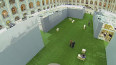 People walk by green carpet during Festival of Architecture Stock Footage