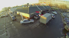 MacAuto McDonalds service with queue of cars near road Stock Footage
