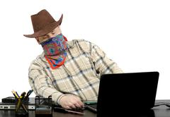 Stock Photo of thief stealing data from another laptop using usb flash drive