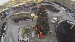 Stock Video Footage of Worker in cabin of elevating machine adorns christmas tree