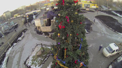 Man in cabin of hoisting machine adorns christmas tree Stock Footage