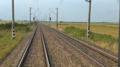 Timelapse pov train pass fast motion moving vegetation panorama line track day Stock Footage