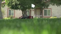 Golf Course Greenskeeper Mows Grass Around Green -1 Stock Footage