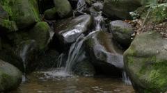 Mountain stream running over mossy rocks. European Alps. 4K UHD Stock Footage