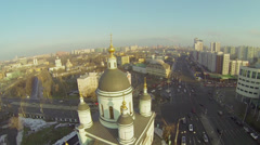 Cityscape with traffic near church of St. Sergey Radonezhsky Stock Footage