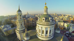 Cupola and belltower of St. Martin the Confessor temple against cityscape - stock footage