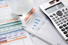 Financial charts and graphs on the table Stock Photos