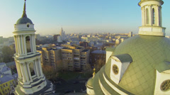 Cityscape with belltower and cupola of church Stock Footage