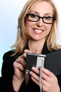Businesswoman using a pda organizer - stock photo