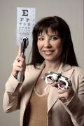 Eye doctor with equipment Stock Photos