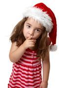 Santa girl hushing or gesturing for quiet Stock Photos