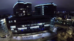Office center Cvetnoy Legend against cityscape at winter night Stock Footage