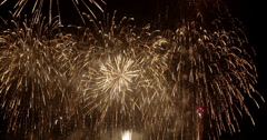 Fireworks against night sky on New Years Eve - stock footage