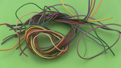 Multicoloured six amp electrical wire rotating on a green background. Stock Footage