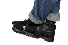 Jeans and shoes on white close up Stock Photos