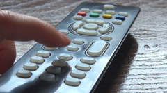 Woman hand change tv channel program selective typing choice finger domestic day Stock Footage
