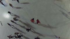 People slide by skating rink in recreational park Sokolniki Stock Footage
