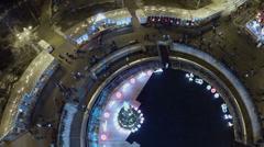 People walk by Sokolniki park with christmas tree - stock footage
