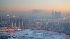 Aerial winter cityscape with different buildings and smoke Stock Footage