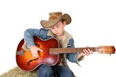 Boy strumming guitar - stock photo