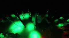 Man walks around a pole in labyrinth illuminated stroboscopic Stock Footage