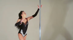 Dancer doing acrobatic tricks upside down and rotate around pole Stock Footage