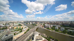 Stock Video Footage of Wide cityscape view with many buildings, river, sky and clouds.
