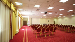 Screen, chairs and projector in empty conference hall - stock footage